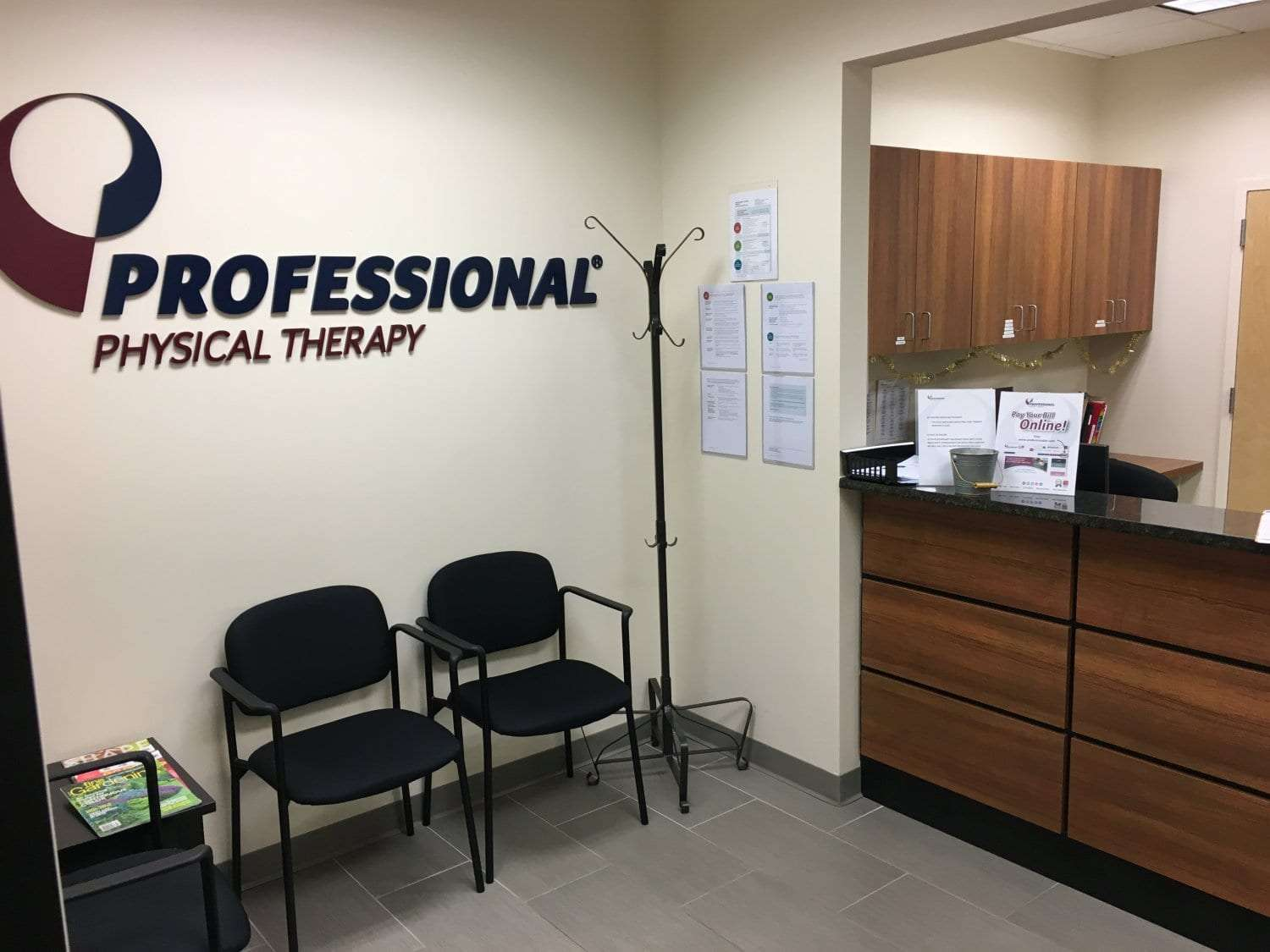 An image of two chairs in the waiting area in front of the check-in desk at our physical therapy clinic in Mahwah, New Jersey.