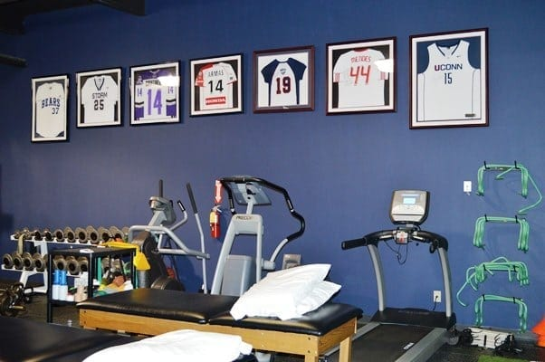 This is a photo of the interior of our physical therapy clinic. There are jersey in frames on the wall at our facility in Garden City, New York.