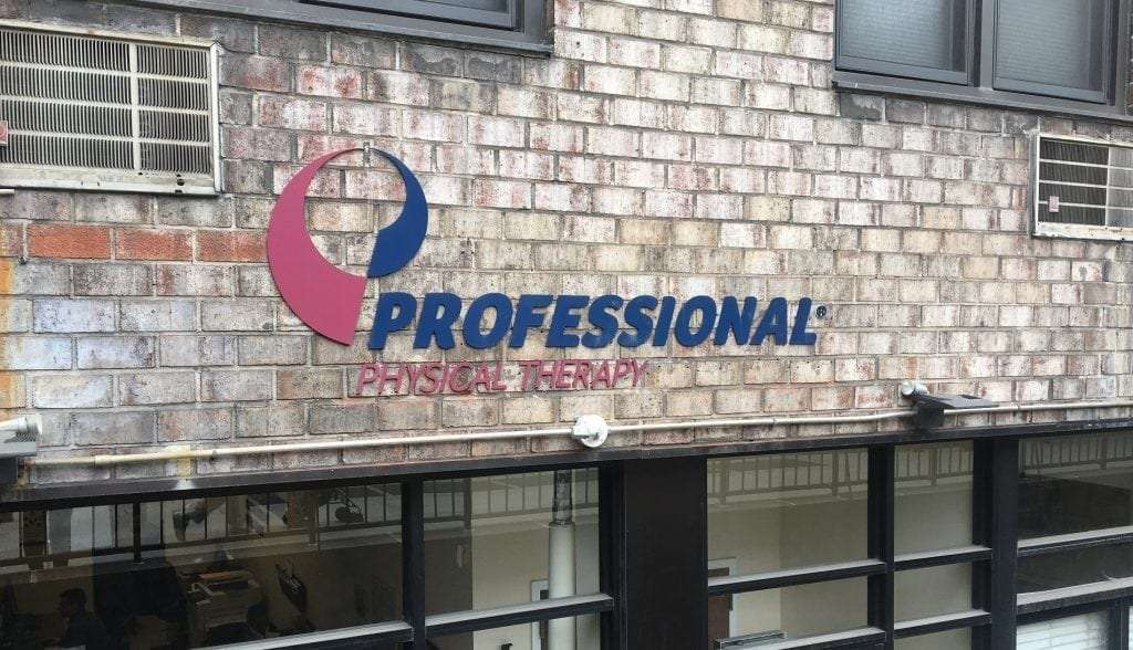 An image of the sign for our physical therapy clinic in lower Manhattan, New York City at City Hall.