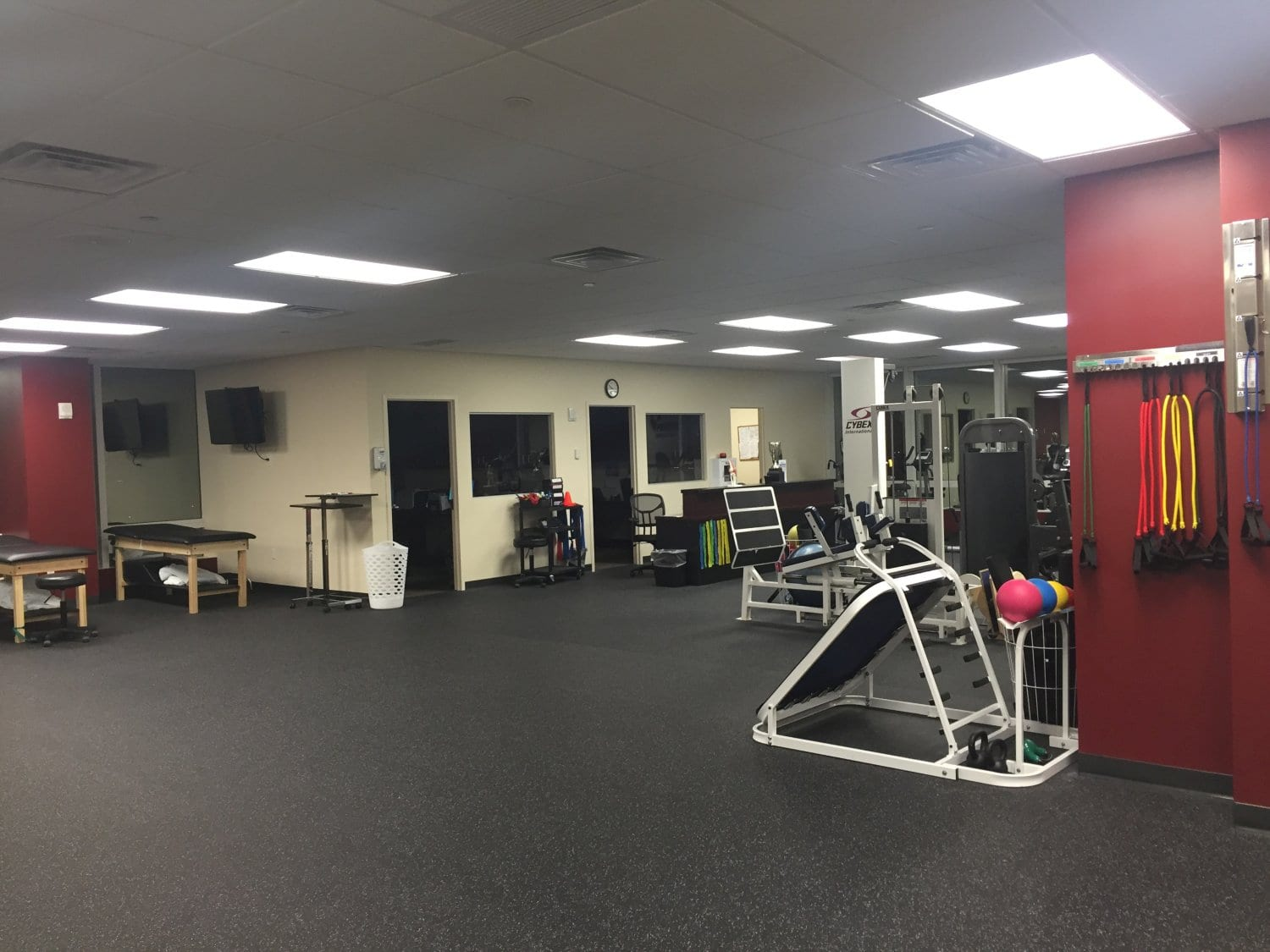 Another angle of the training area at our physical therapy clinic in Bronx, NY. There are stretch bands hanging on the wall which are great for strength training.