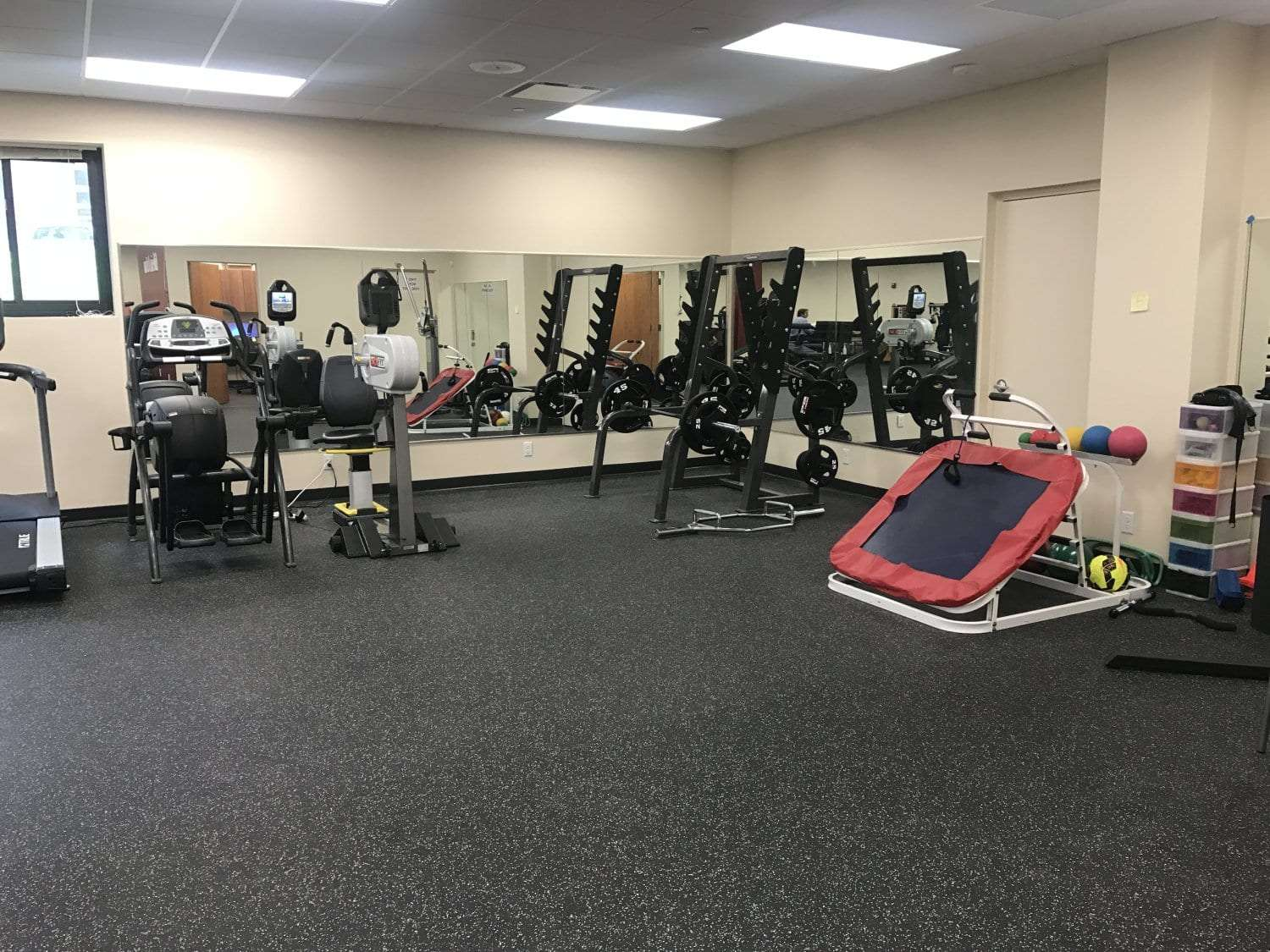 Here is an image of a room of exercise equipment at our physical therapy clinic in Pleasantville, New York.