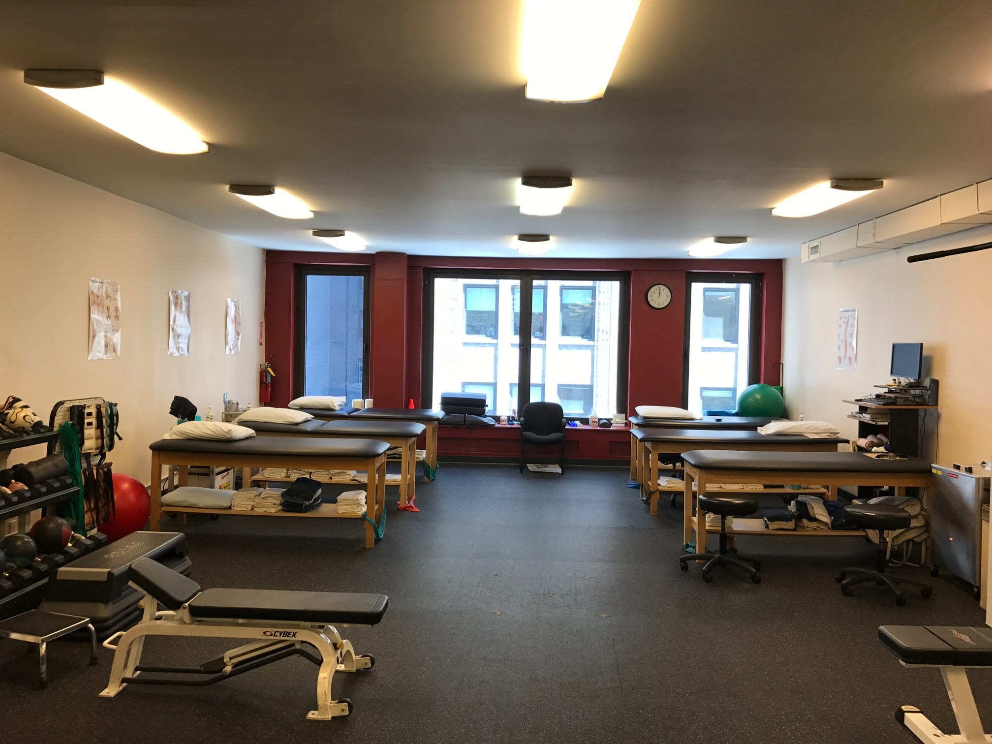 This is a photo of the training area including stretch beds and exercise equipment at our physical therapy clinic in Madison Avenue, New York in Manhattan at Midtown East.