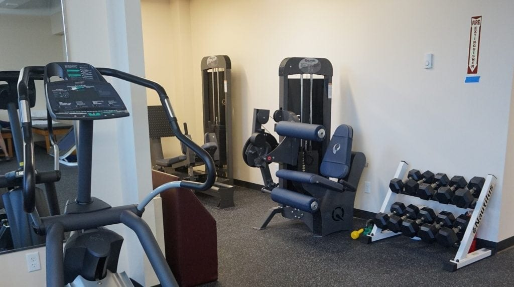 Here is a photo of a rack of weights and a couple of machines used for physical therapy at our clinic in Hartsdale, New York.