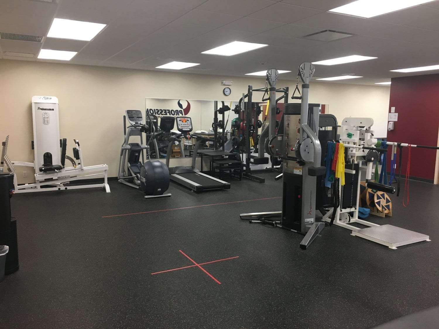 An image of the interior of our physical therapy clinic in Katonah, New York. This photo shows the various pieces of equipment used for training.