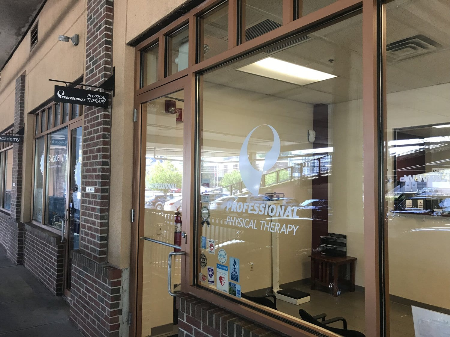 An image of the window with our logo at our physical therapy clinic in Montclair, New Jersey at Greenwood.