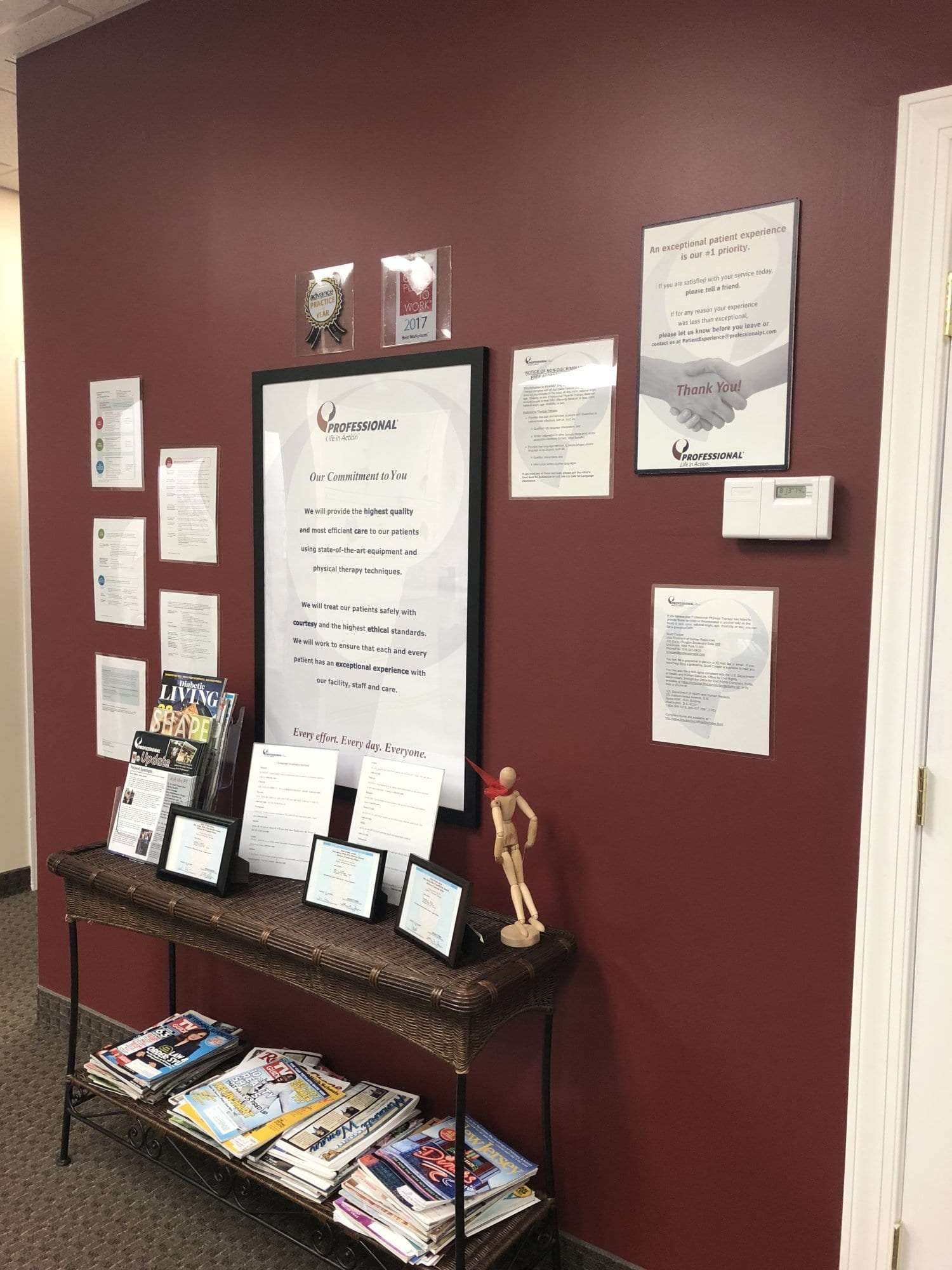 An image of signs on a wall at our physical therapy clinic in Hazlet, New Jersey.