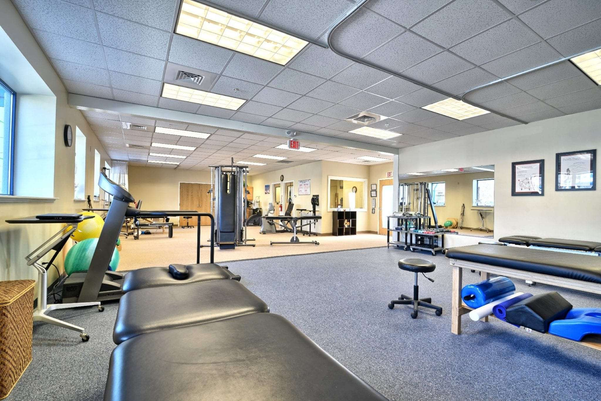 A photo of stretch beds and a treadmill at our physical therapy clinic in Amesbury, Massachusetts.