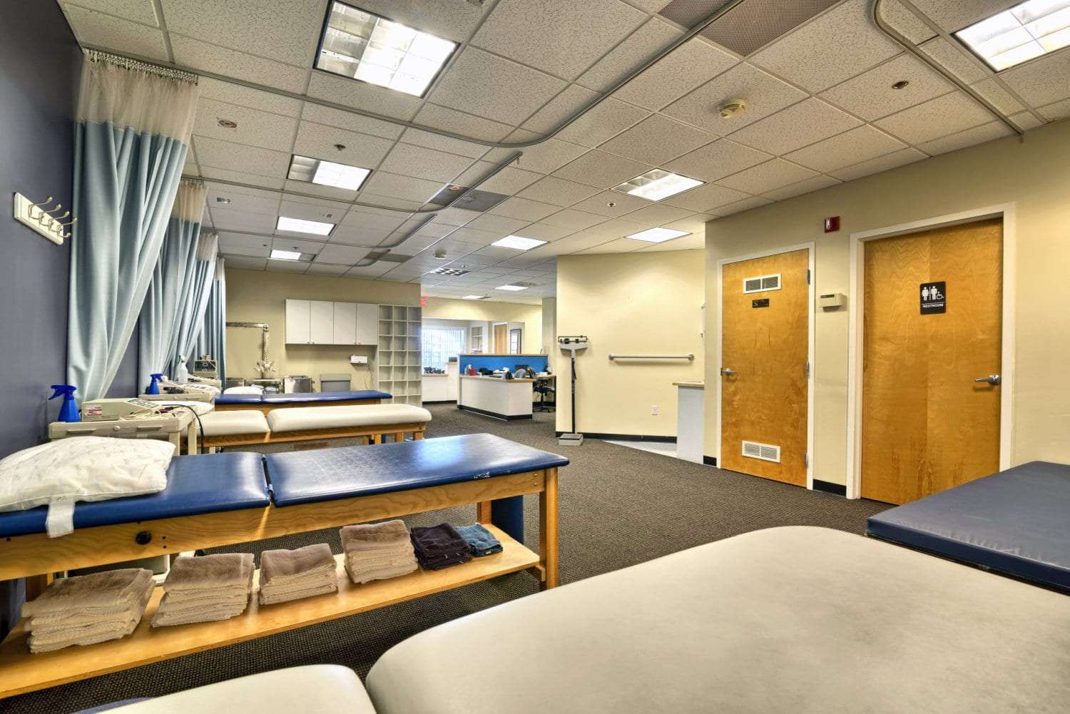 A photo of blue and white stretch beds at our physical therapy clinic in Salem, Massachusetts.