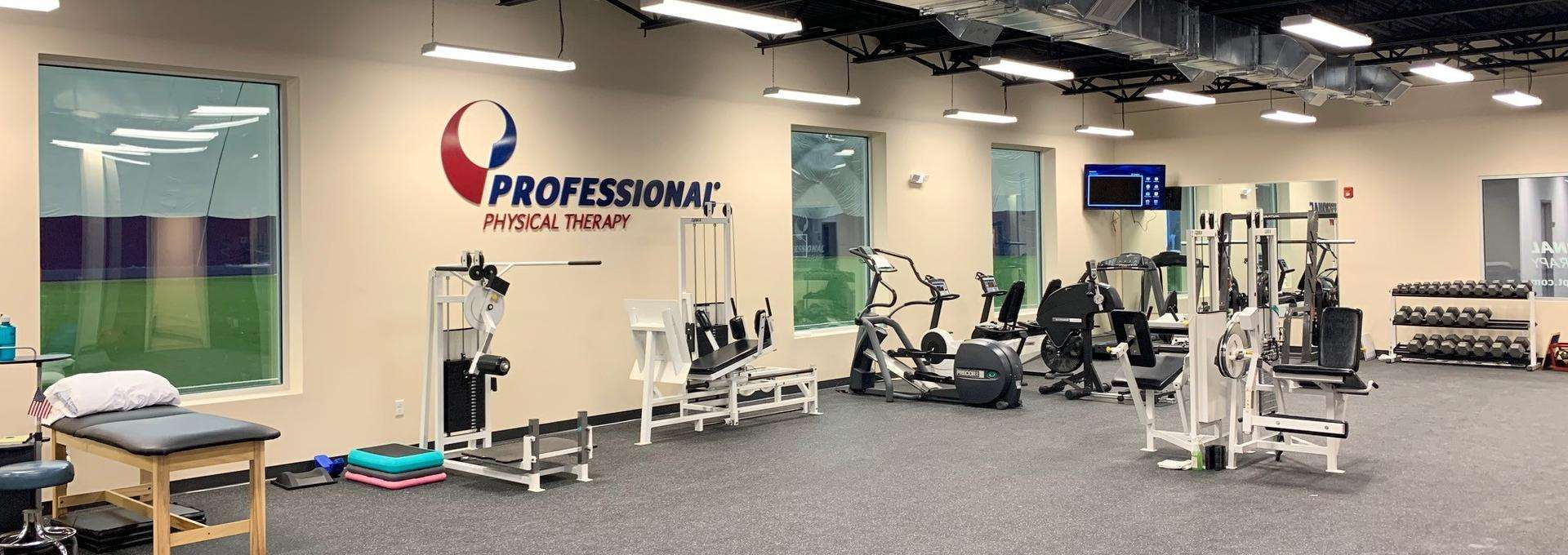 Inside of our physical therapy and sports medicine clinic in Florham Park New Jersey with our turf athletic training field in the background.