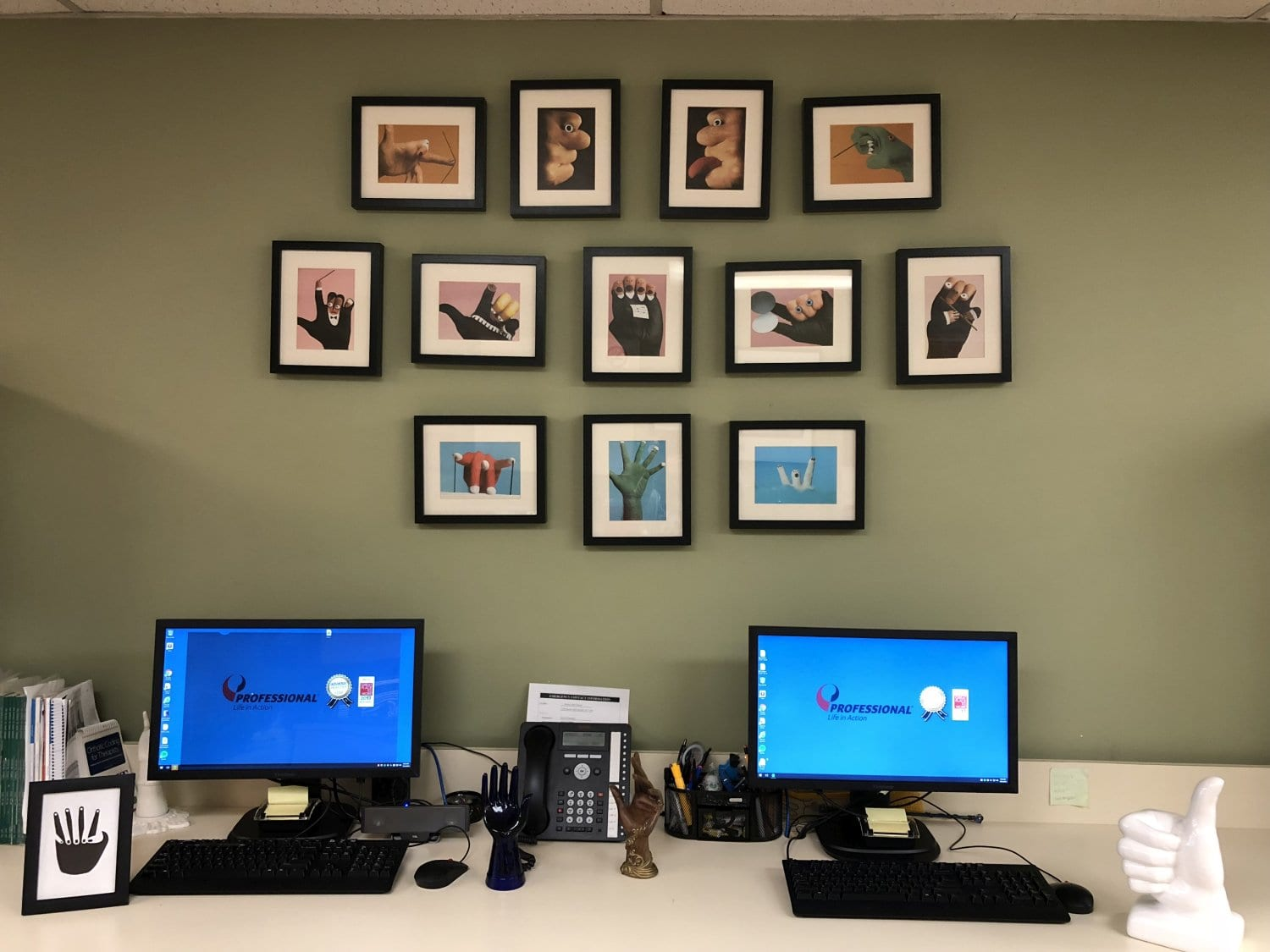 An image of a wall with pictures of hands at our physical therapy clinic in Merrick, New York.