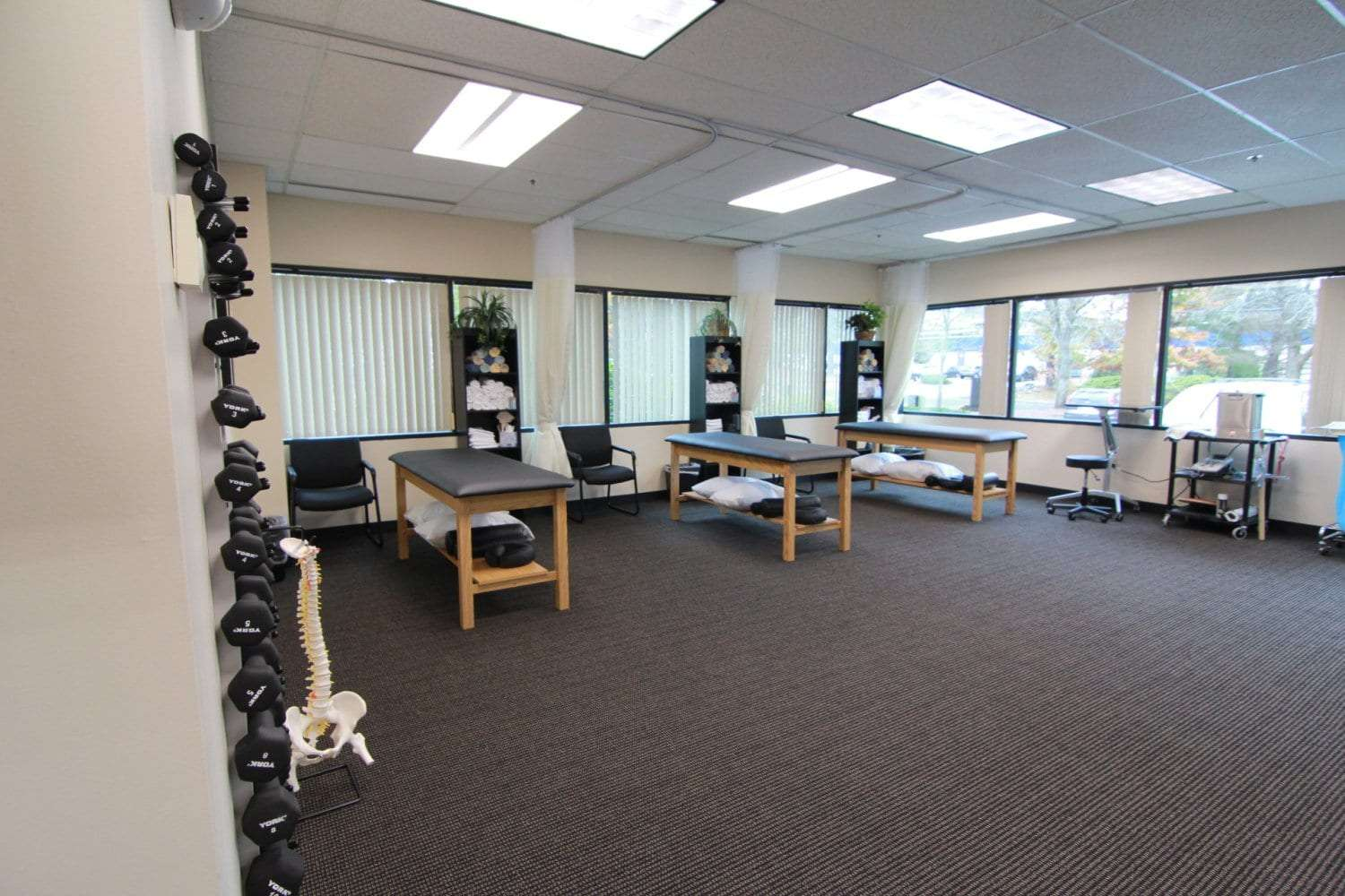 An image of stretch beds in a brightly lit room at our physical therapy clinic in Billerica, Massachusetts.