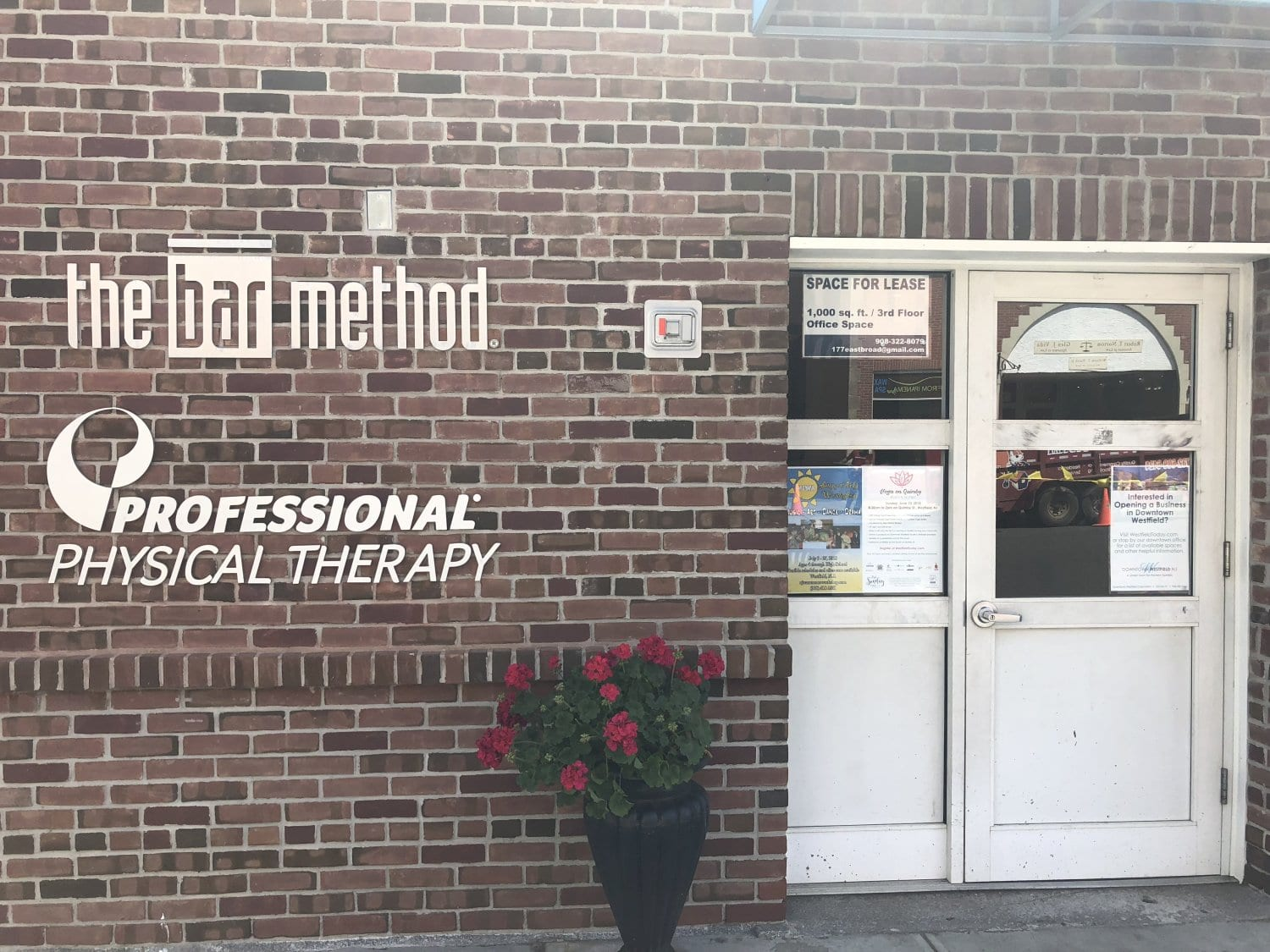 Here is the outside of our Westfield New Jersey physical therapy clinic. There building is brick and the entrance has a white door.