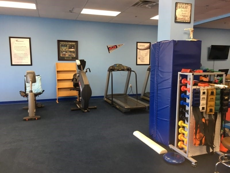 Equipment and colorful weights at our professional physical therapy clinic in Tyngsborough, MA.