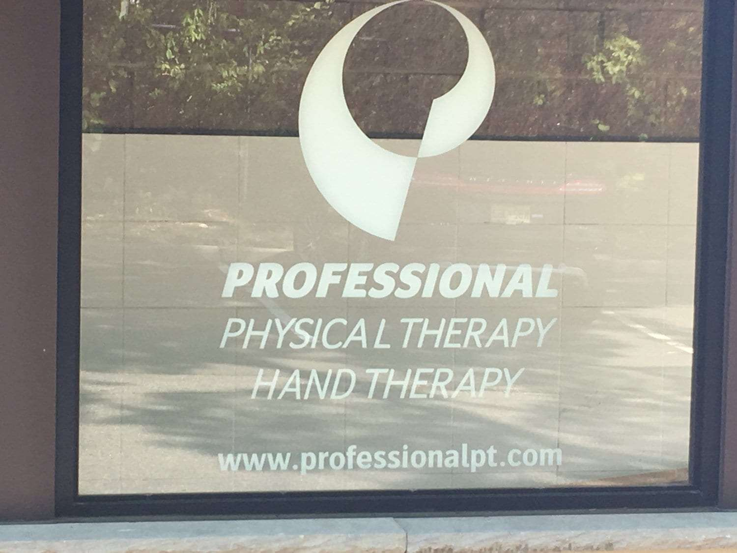 Here is a window at our clinic. The window says