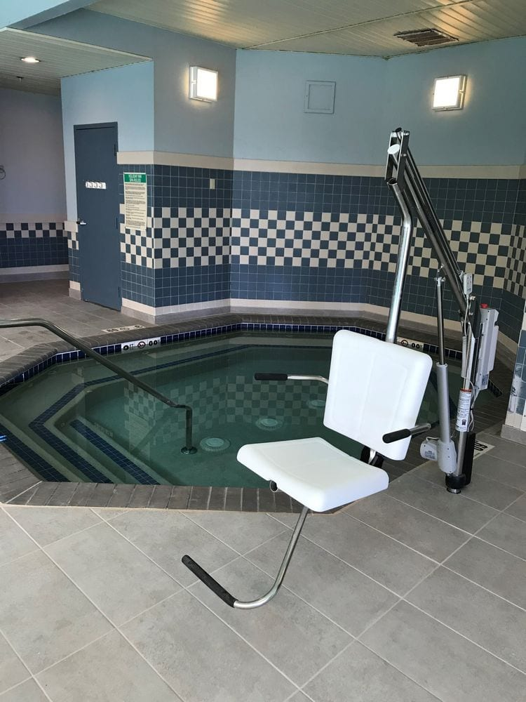 Professional physical therapy clinic in Taunton, MA indoor hot tub and chair.