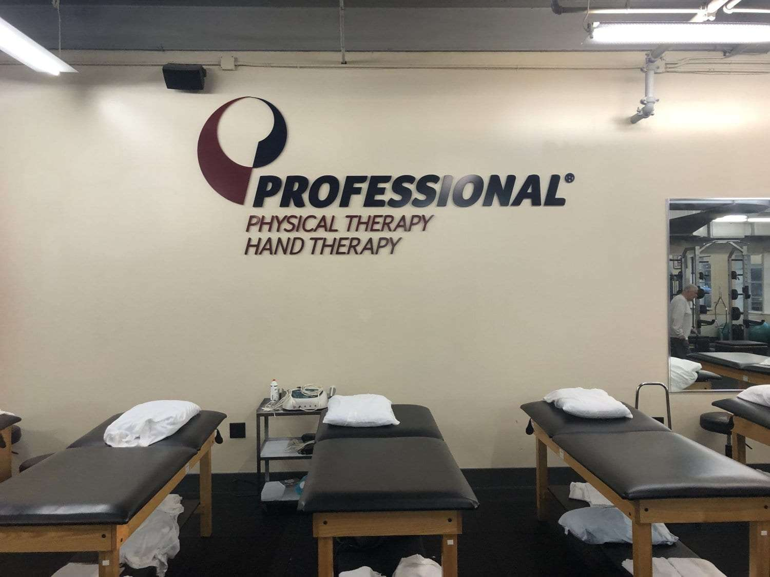 Here is an image of three stretch beds under the Professional Physical Therapy Hand Therapy sign at our clinic in Melville, Long Island in Suffolk County, New York.