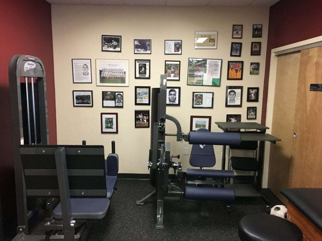 Here is a photo of a training area at our physical therapy clinic in Mahwah, New Jersey. There are many photographs of athletes hanging on the wall.