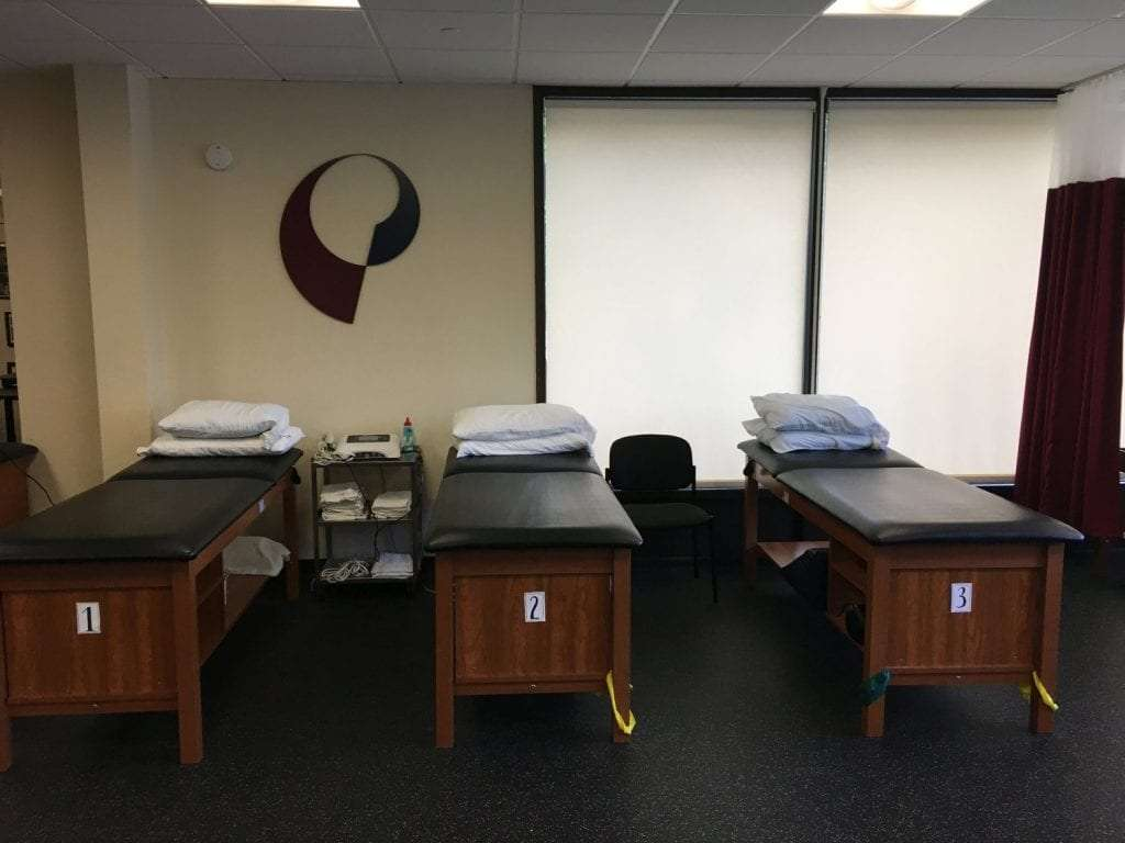 An image of three clean and prepared physical therapy stretch beds at our clinic in Mahwah, New Jersey.