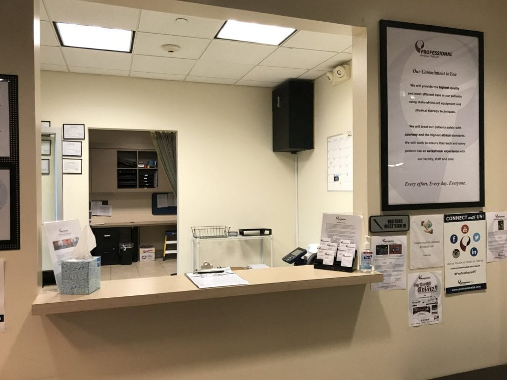 A photo of the desk where patients check in at our physical therapy clinic in Great Neck, New York.