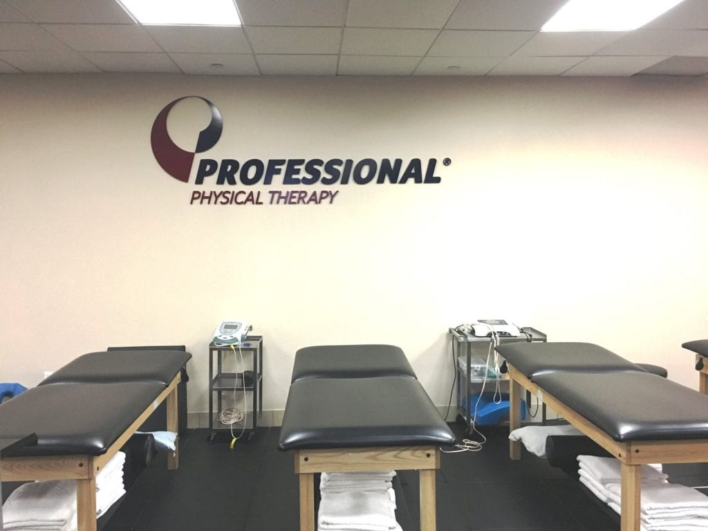 An image of stretch beds at our clean facility. There is a Professional Physical Therapy sign on the wall at our clinic in Manhattan, New York City at Midtown East on Fifth Avenue.