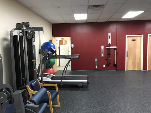 An image of exercise balls and a treadmill at our physical therapy clinic in Marine Park, New York.
