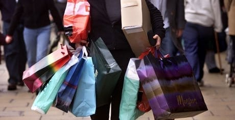 Woman Carrying Many Bags