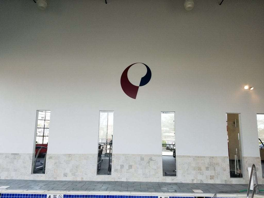 An image of our logo on the wall near the pool at our physical therapy clinic in Copiague, New York.