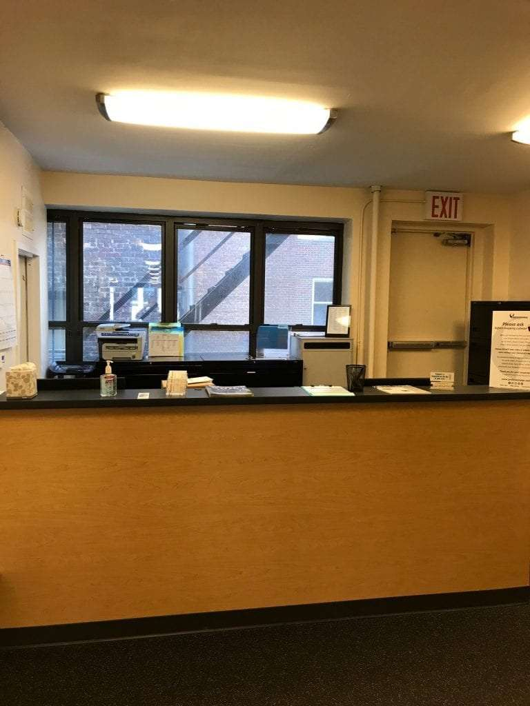 A photo of the front desk where patients check in at our physical therapy clinic in Madison Avenue, New York in Manhattan at Midtown East.