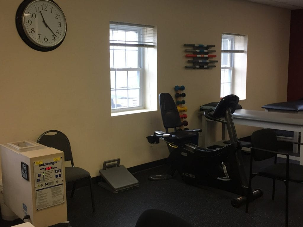 Here is a photo of weights on a wall at our physical therapy clinic in Medford, New York in Long Island in Suffolk County.