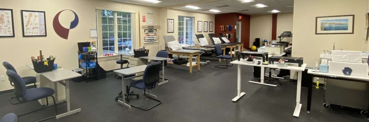 Interior of our Riverhead, NY physical therapy clinic with exercise beds and hand therapy stations.