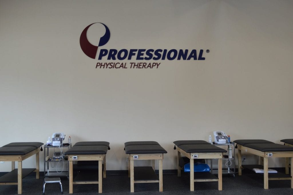An image of five stretch beds along a wall at our physical therapy clinic in Hicksville, New York.