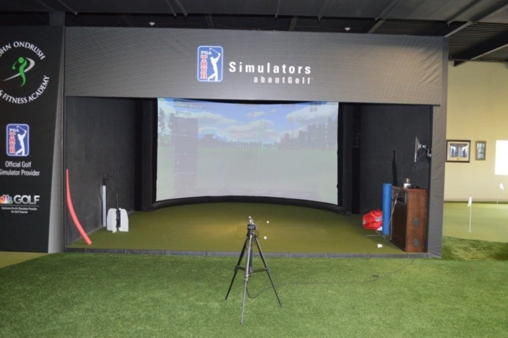 This is an image of our golfing simulator at our physical therapy clinic in Syosset, New York.