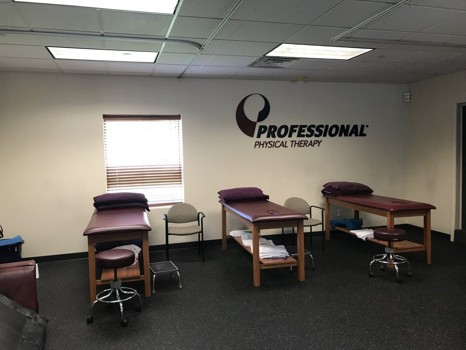 An image of three stretc beds used in physical therapy at our clinic in East Hanover, New Jersey.