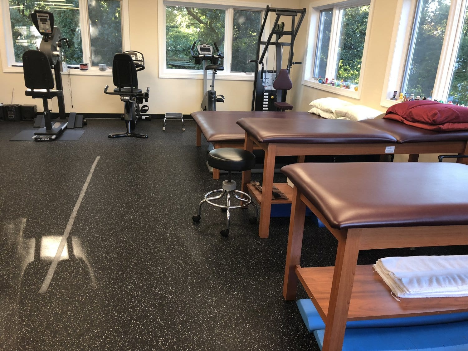 An image of three beds and physical therapy equipment at our clinic in Hazlet, New Jersey.