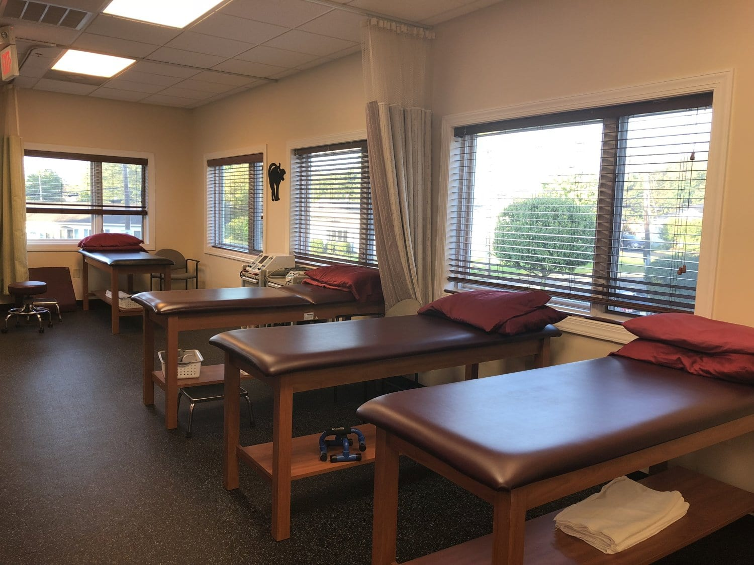 An image of four beds at our physical therapy clinic in Hazlet, New Jersey.