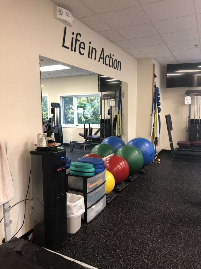 An image of medicine balls in front of a wall mirror at our physical therapy clinic in Hazlet, New Jersey.