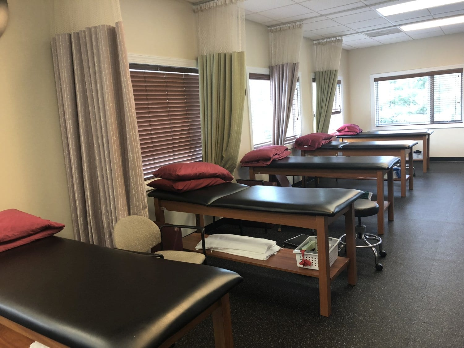 An image of five stretch beds at our physical therapy clinic in Hazlet, New Jersey. These are great for increasing flexibility.
