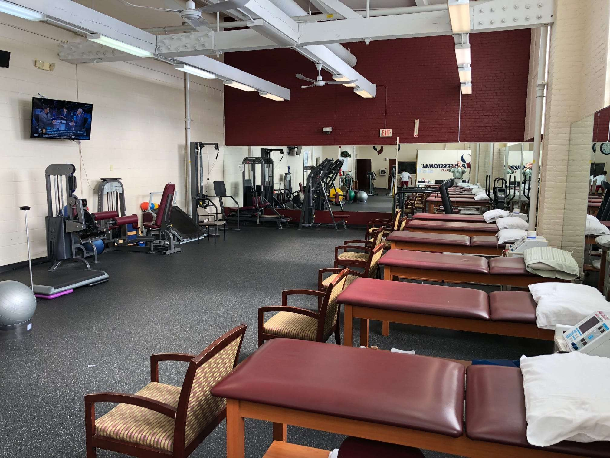THis is an image of our training area with red stretch beds at our physical therapy clinic in Newark, New Jersey.
