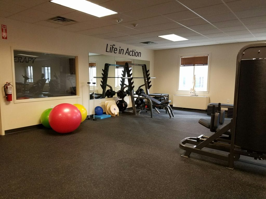 An image of weights and exercise balls in our training room at our physical therapy clinic in Hoboken, New Jersey.