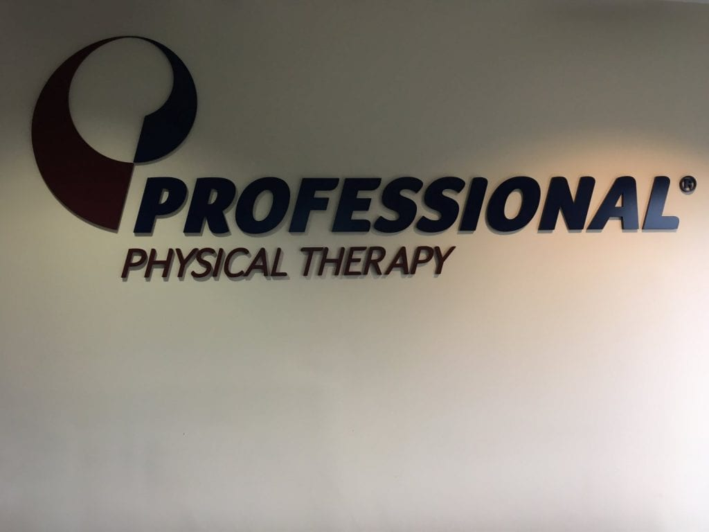 An image of the Professional Physical Therapy sign on the wall at our clinic in Oradell, New Jersey.