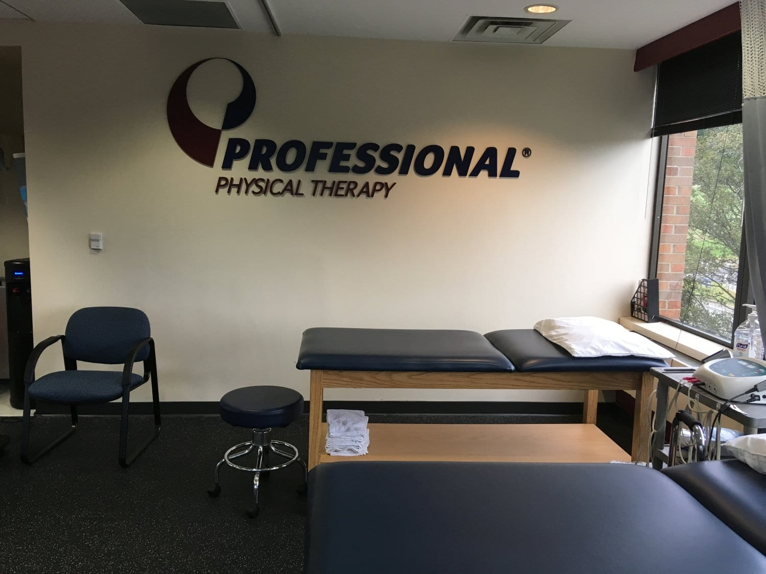 Here is an image of a stretch bed with a sign over it. The sign says Professional Physical Therapy. This is in the training room at our clinic in Oradell, New Jersey.