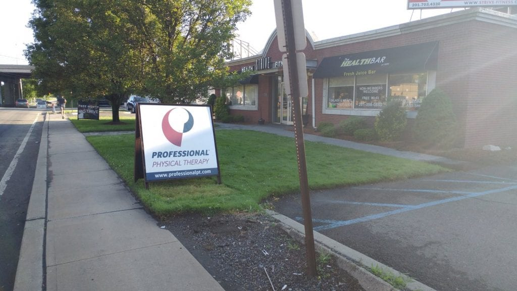 Here is a photo of our sign at our clinic. The sign reads