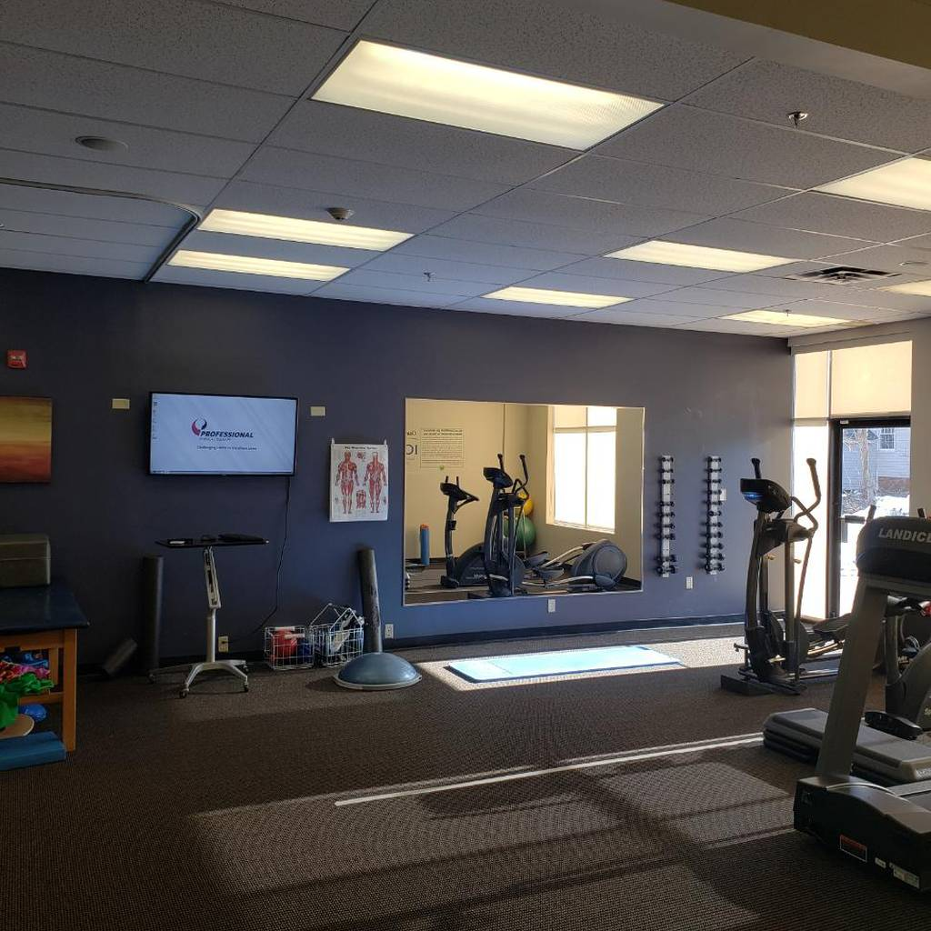 Interior of our Haverhill, MA physical therapy clinic on Main St with a TV on the wall and equipment.