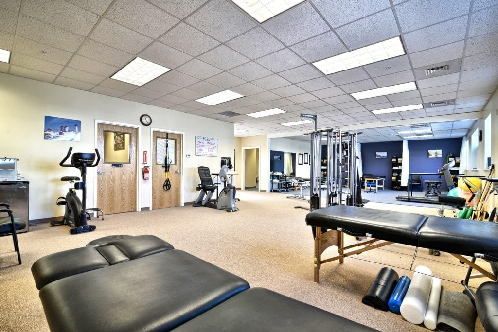 An image of stretch beds and exercise equipment at our physical therapy clinic in Amesbury, Massachusetts.