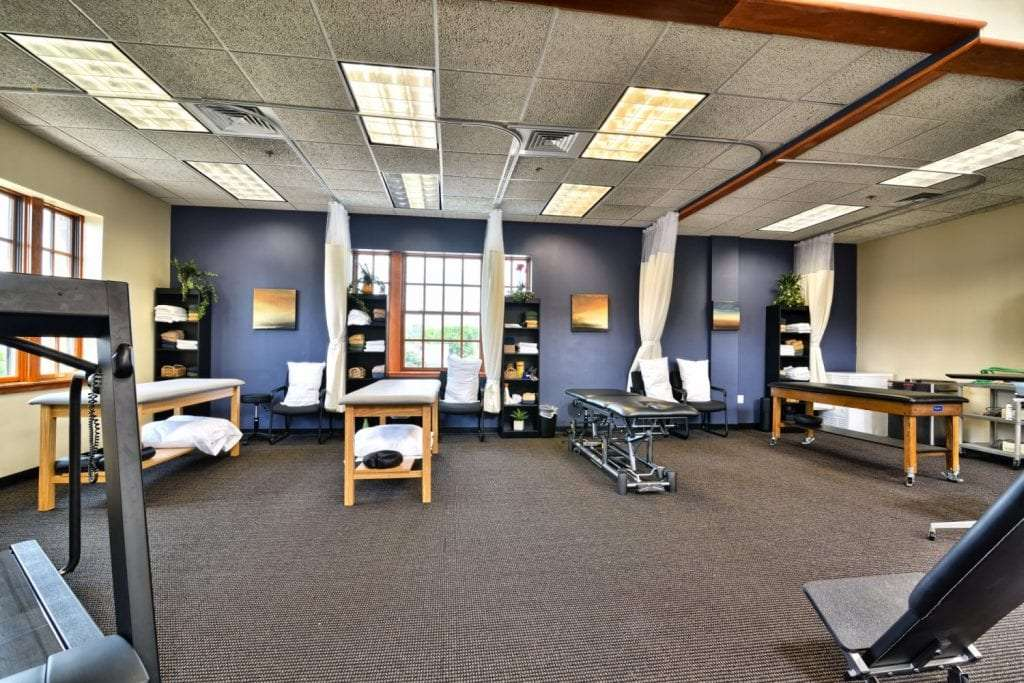 An image of four stretch beds at our physical therapy clinic in Arlington, Massachusetts.