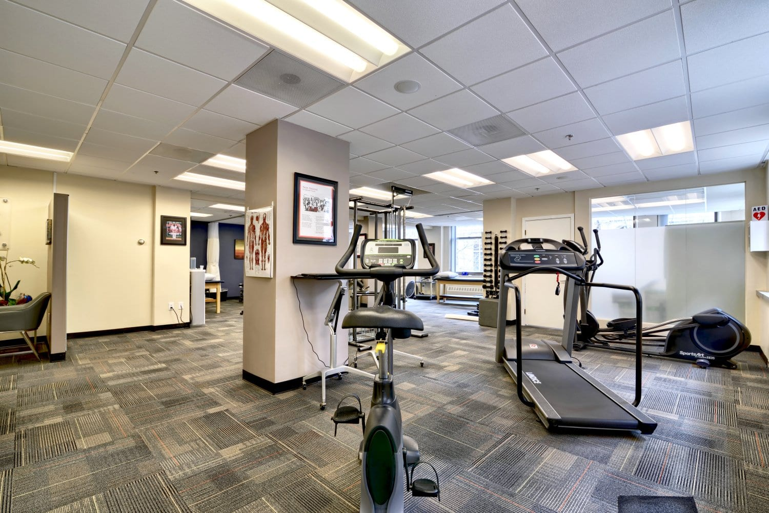 This image shows a treadmill and a bike at our physical therapy clinic in Boston, Massachusetts.