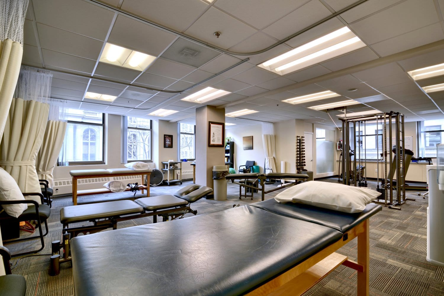 This is an image of the interior of our clean physical therapy clinic in Boston, Massachusetts. This image shows clean equipment and stretch beds.