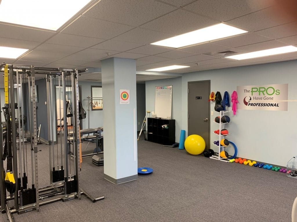 Colorful weights and exercise equipment at our professional physical therapy clinic in Braintree, MA.