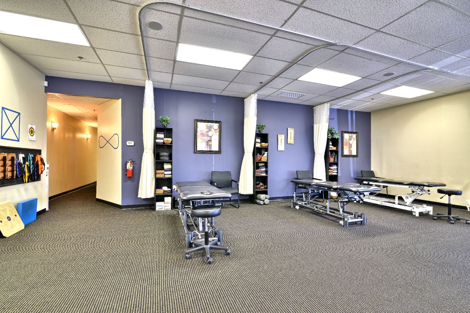 Here is an image of the interior of our clean facility. The image showcases our stretch beds at our physical therapy clinic in Middleton, Massachusetts.