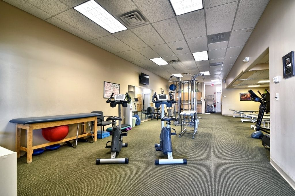 A photo of the interior of our facility, showing various exercise equipment at our physical therapy clinic in Epping, New Hampshire.